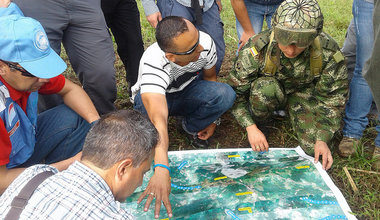 UN staff and observers carry out planning work for the mission in the field