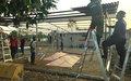 Trabajando día y noche para finalizar un campamento en Putumayo donde la Misión de la ONU verificará la dejación de armas